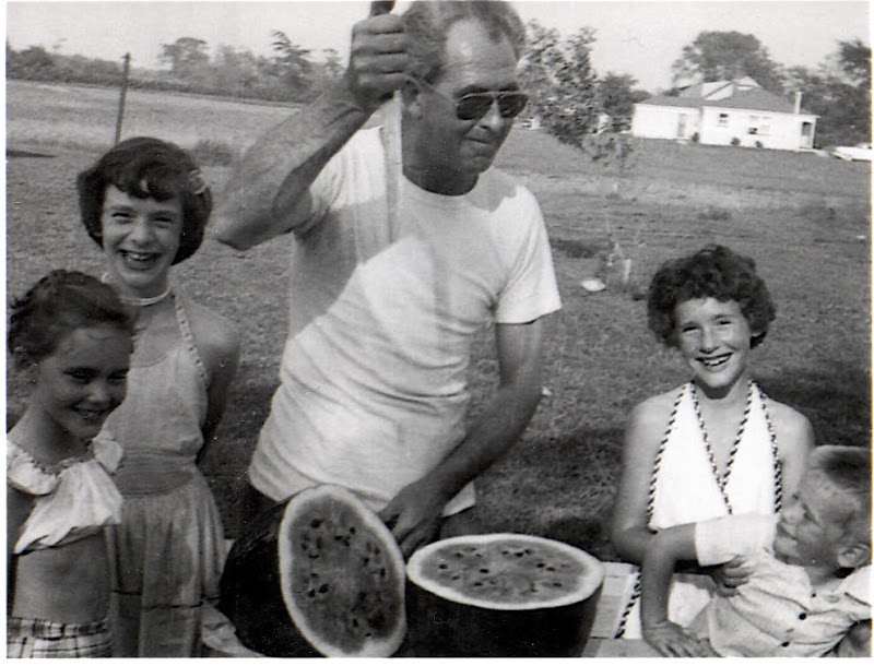 Lee Cutting Watermelon with Francie, Sue Maul, Sherrie Caldwell and a neighbor boy
