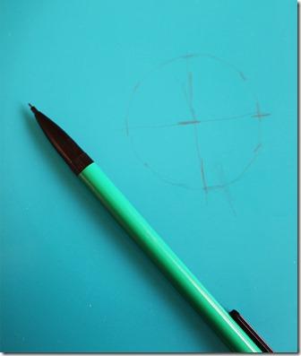 Bild på penna och rund markering med kryss i mitten
