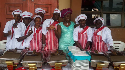 Chef Faouzy with her servers