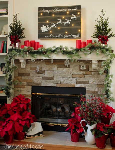 Chistmas Mantel featuring lighted Santa and Reindeer Sleigh Reclaimed Wood Sign