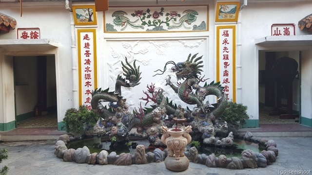 Dragon sculpture in the Phuc Kien (Fujian) Assembly Hall with live goldfishes in water feature below.