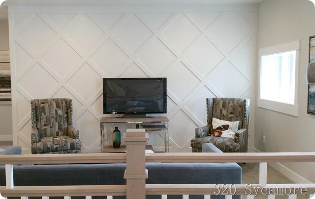 geometric wall pattern behind tv