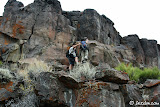Lewis ensures Cori doesn't fall while photographing some petroglyphs on a basalt ledge.
