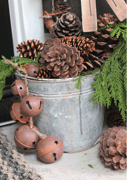 Bucket of pine cones and aged sleigh bells