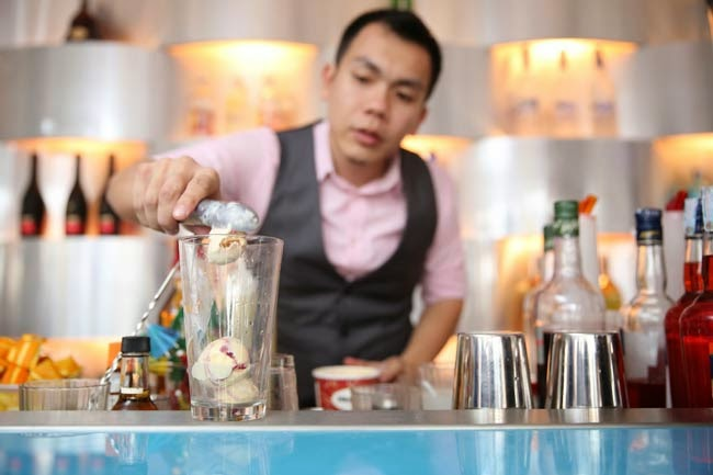 Mixologists serving cocktails new Haagen-Dazs Mango and Raspberry flavor