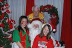 Don Davis. Front - Dominique Davis, Santa (Dax Davis) and Genevieve Davis photos by Carol Wollin