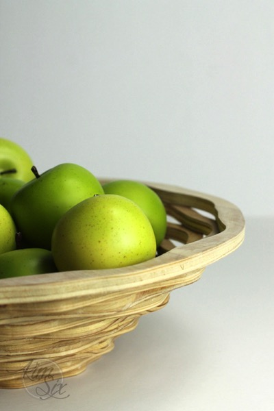 Apples in a wooden scroll saw bowl