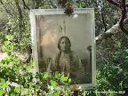 Photo of Sitting Bull next to Sitting Bull Plaque along Temalpa Trail