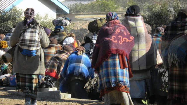 Behind this crowd of ladies are the Bojale initiates entering the crall