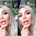 Kim Kardashian shows off new customized mouth bling