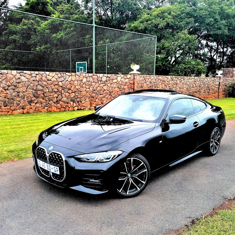 The BMW 4 Series coupe is a slinky and exciting alternative to the 3 Series. Picture: PHUTI MPYANE