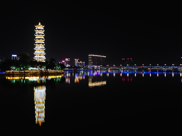 Tongtian Pagoda (通天塔) and Beijiang Bridge (北江大桥) lit up at a night in Shaoguan