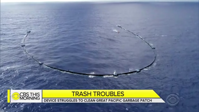 Aerial view of the Ocean Cleanup project's plastic collecting boom at sea. Photo: CBS News
