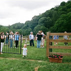 Whitney Leigh Philpott plays with the gate at the William Gleaves cemetery in Wythe County, Virginia June 2009