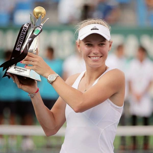 Caroline Wozniacki of Denmark holds up her trophy after her victory against Roberta Vinci of Italy in their tennis final match at the Istanbul Cup in Istanbul, Turkey, Sunday, July 20, 2014. Wozniacki overpowered second-seeded Vinci 6-1, 6-1 Sunday to win the Istanbul Cup final and clinch her first WTA title of the year.