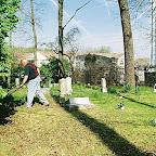 Tom mows the cemetery