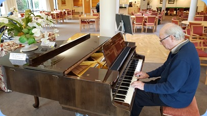 George Watt playing the Schimmel grand piano.