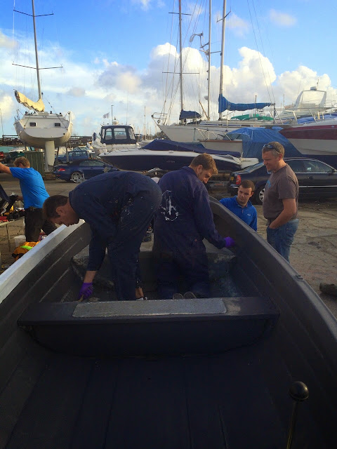 Poole volunteer crew members prepare to rub down and touch up the boarding boat at Cobbs Quay - 2 November 2014.  Photo credit: Paul Taylor