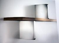 裝潢五金 品名:義大利進口層板架 層板厚度:8~25m/m 層板深度:最大240m/m 承重:30KG(每對) 材質:ABS塑料 顏色:亮銀/霧銀色 玖品五金