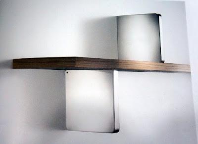 裝潢五金品名:義大利進口層板架層板厚度:8~25m/m層板深度:最大240m/m承重:30KG(每對)材質:ABS塑料顏色:亮銀/霧銀色玖品五金