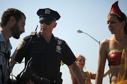 An police officer ensures that the press behaves during the Coney Island Mermaid parade.