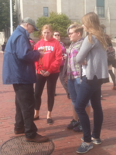Wayne shares a gospel object lesson with three students at Boston University.