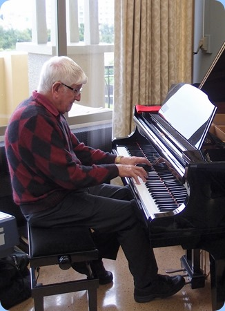 Bennie Gunn playing the K. Kawai grand pinao.
