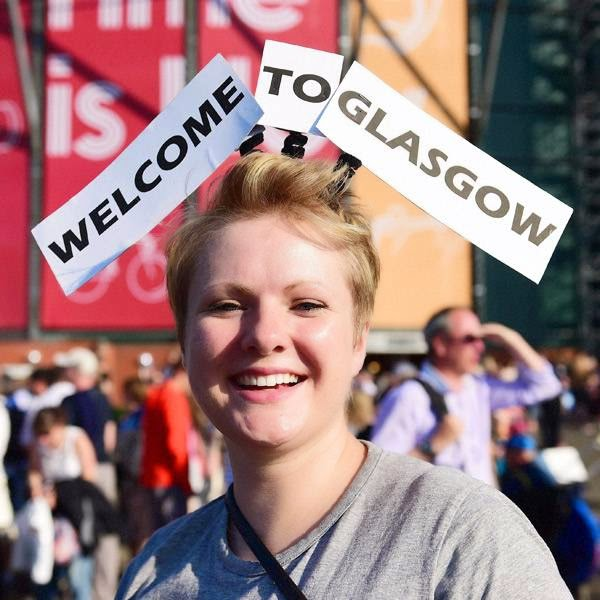 A foreigner sports a head gear ahead of the opening ceremony of Commonwealth Games in Glasgow, Scotland.