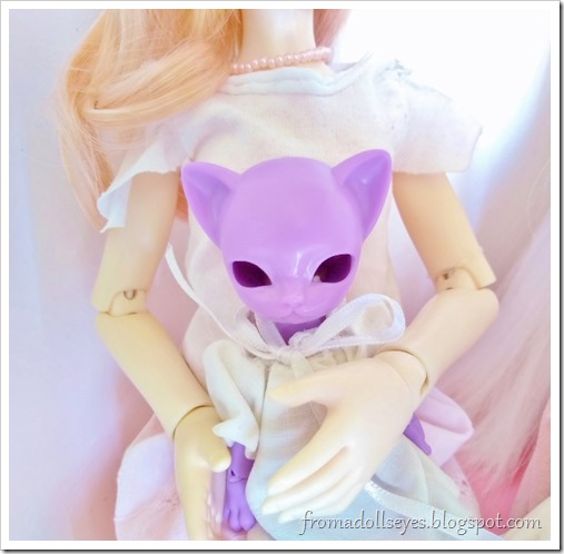 The purple kitty doll without eyes.  The pink eyes are for her.