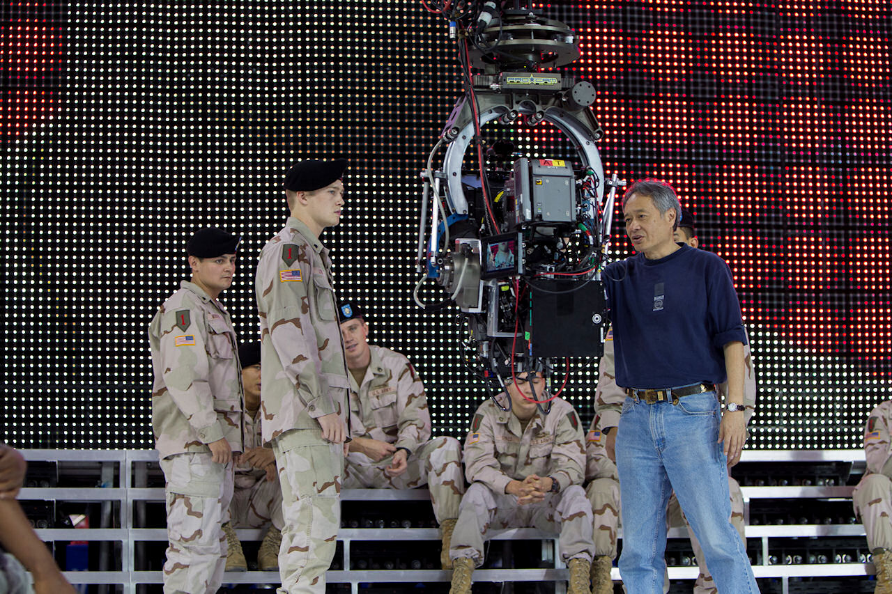 Joe Alwyn and Director Ang Lee on the set of TriStar Pictures' BILLY LYNN'S LONG HALFTIME WALK. (Photo by Mary Cybulski / courtesy of Sony Pictures).
