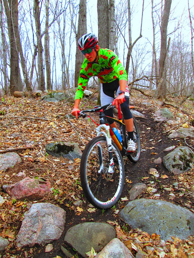 Rolling through a rock section on Twin Lakes singletrack