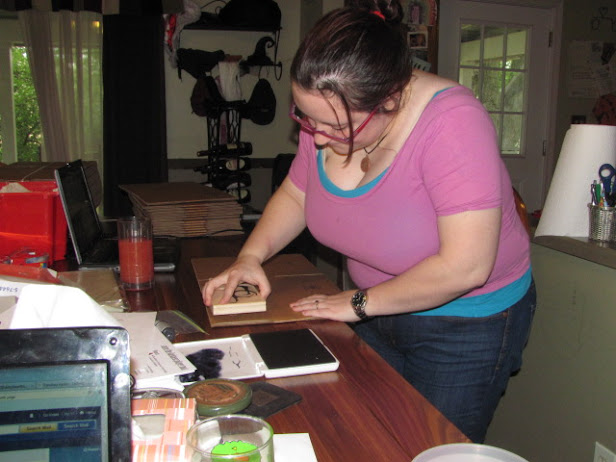 Sarah stamping the Kits with the Symbol.