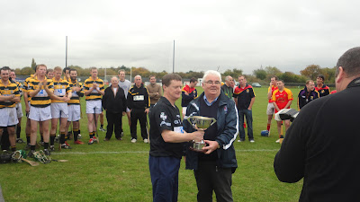 John O' Farrell accepting the cup