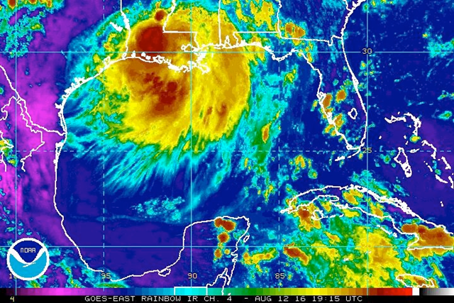 Enhanced infrared satellite image for the central Gulf Coast reveals the vast scope of the area of low pressure generating torrential rains in southeast Louisiana, 12 August 2016. Graphic: NOAA/NESDIS