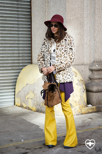Red hat; Leopard print coat; yellow leather trousers;