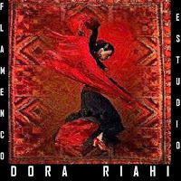 who is Dora Riahi contact information