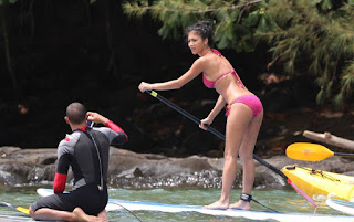 Nicole Scherzinger caught paddling in a river wearing a li'l pink bikini