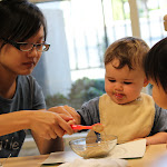 LePort Private School Irvine - Montessori teacher helping baby self-feed