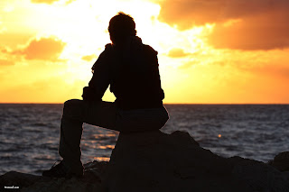 man-sitting-sunset