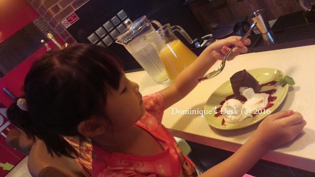 Tiger girl tucking into her dessert