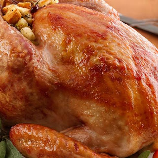 Glazed Roast Turkey with Cranberry Stuffing.