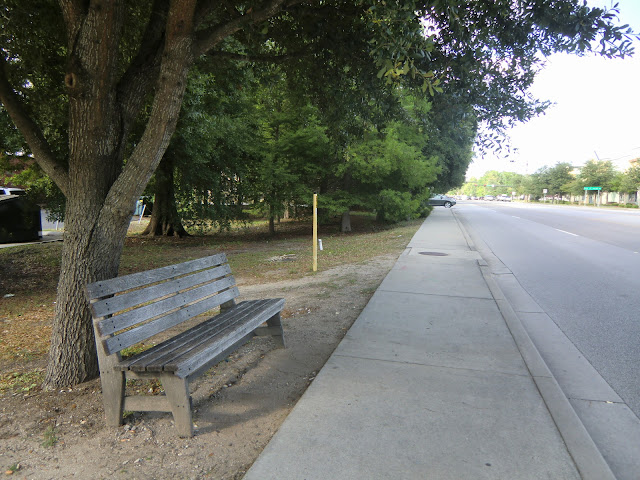 A picture of the bench with no curb access on Long Point Road.  We are working to make this a better system for all to use.