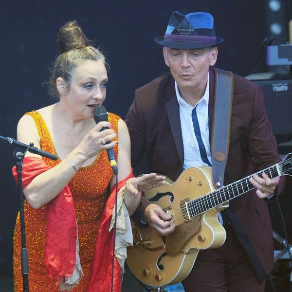French singer Catherine Ringer (L) and member of the Gotan Project band, Eduardo Makaroff, perform during a concert in La Rochelle on July 12, 2014 at the Francofolies festival.