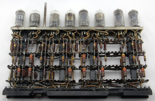 This tube module from an IBM 705 mainframe computer, implemented five key debouncing circuits.