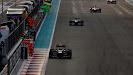 Romain Grosjean, Lotus E21 Renault, leads Lewis Hamilton, Mercedes W04
