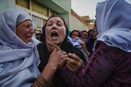 Pg 114 Women s rights activists grieve at the home of Farkhunda Malikzada jpg CROP original original