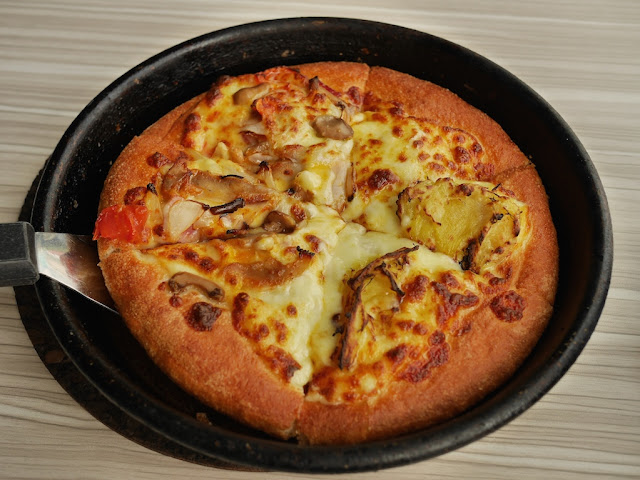 half New Orleans style and half durian pizza at Pizza Hut in Jieyang, China