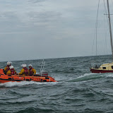 Swanage D-class lifeboat escorting the 23ft yacht south of Old Harry Rocks - 28 September 2013. Photo credit: RNLI / Rob Inett