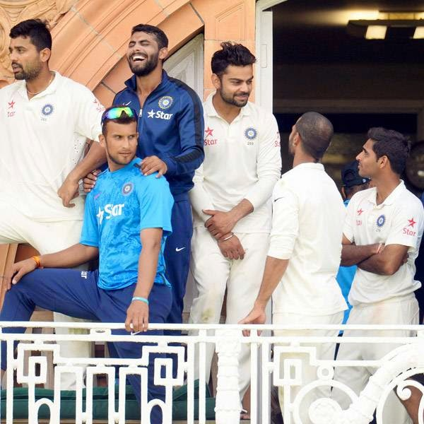 India's players watch the presentations from the dressing room balcony after they won the second cricket test match against England at Lord's cricket ground in London July 21, 2014.