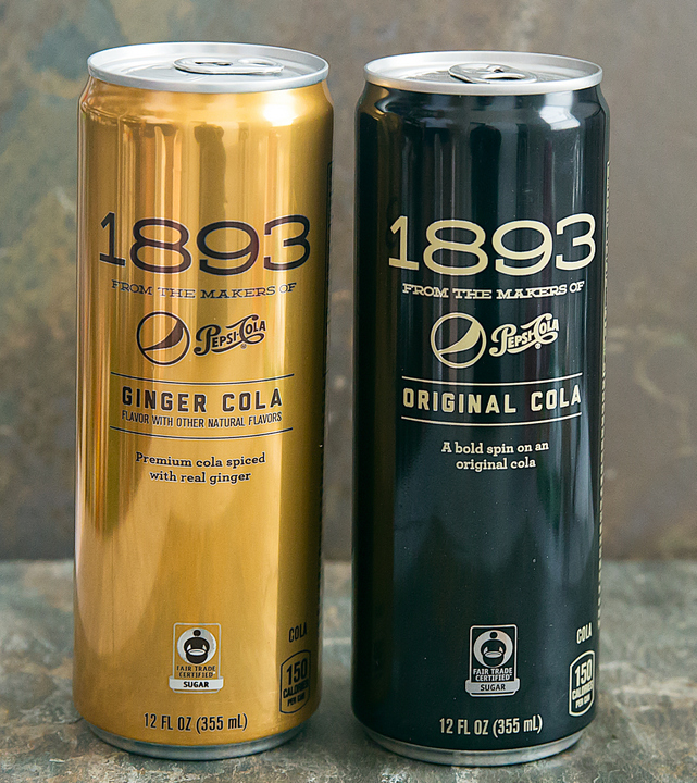 one gold can and one black can of pepsi 1893
